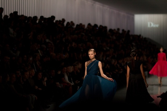 A vision in cobalt. Model Magdalena Frackowiak sashays down the runway in one of Dior's ballerina-inspired gowns.