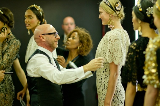 Stefano Gabbana touching up model Toni Garrn backstage at Dolce and Gabbana.