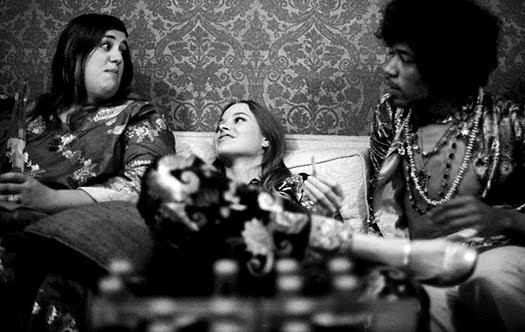 What could Cass, Michelle, and Jimi Hendrix  possibly be discussing? I propose it's the commonalities in  the ornate detailing of their garments.