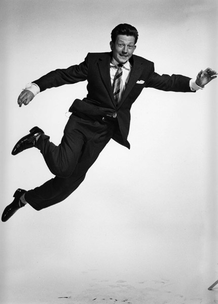 Donald O'Conner, in a pose akin to his character in Singin' in the Rain.