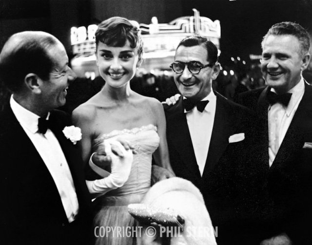 "A 25-year-old Audrey Hepburn with Cole Porter, Irving Berlin, and guest at the premiere of A Star Is Born, 1954. On Hepburn, Stern states: ""That was a symmetrical face, very well designed by God or nature. There's no doubt that she was a beautiful woman, but in a nonsensual way."""